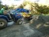 High Tech loading the mechanical barrow