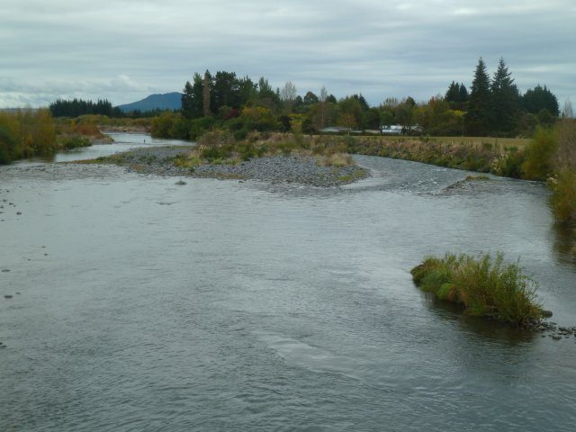 The rip rap on the right has a damaged section that needs repair. The river will be pushed from the channel on the right to the channel on the left.